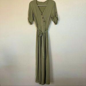Woman's olive green Rebellion jumpsuit zip side